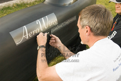 Lonnie Morse applies decals to his streamliner