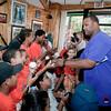 CC Sabathia autographs balls for a bunch of Bronx kids at Jordan's Sports Barber Shop.