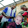 Little Adonis Colon of the South Bronx is frieghten more by the media attention than by CC Sabathia hairstyling skills as Barber Guillermo Leon provides the blowdrying at the Jordan Sports Barber Shop in the Bronx.