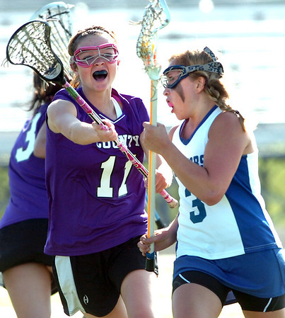 Abby Brown, right, #3 of Centaurus High School  is defended by Shawnie Houser, 11, of  Douglas County during their game in Lafayette on Friday May, 13, 2011<br /> Photo by Paul Aiken / The Camera