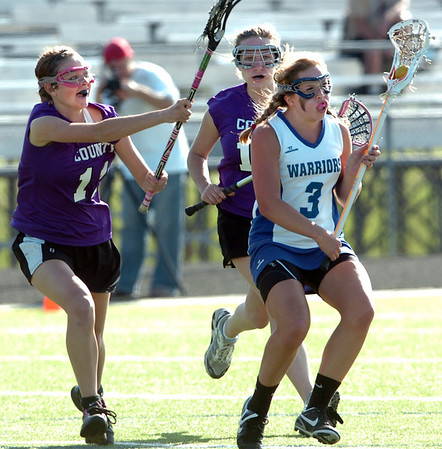 Abby Brown, right, #3 of Centaurus High School  is defended by Shawnie Houser, 11, and Jenna Coy, 18 of  Douglas County during their game in Lafayette on Friday May, 13, 2011<br /> Photo by Paul Aiken / The Camera