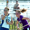 #13 Carley Dvorak, left, of Centaurus High School moves to the goal while #6, McKenna Olson of  Douglas County,  gives chase,  during their game in Lafayette on Friday May, 13, 2011<br /> Photo by Paul Aiken / The Camera