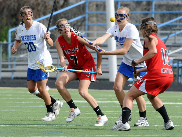"Centaurus High School's 	Sarah Brown (3) battles for a loose ball with Regis Jesuit High School's Ryliegh Mynatt (10) and Erin Schilmoeller (7) during their game in Lafayette Thursday. <br /> For more photos from the game go to  <a href=""http://www.bocopreps.com"">http://www.bocopreps.com</a><br /> Photo by Paul Aiken / The Camera / April 12, 2011"