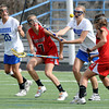 """Centaurus High School's Sarah Brown (3) battles for a loose ball with Regis Jesuit High School's Ryliegh Mynatt (10) and Erin Schilmoeller (7) during their game in Lafayette Thursday. <br /> For more photos from the game go to  <a href=""""http://www.bocopreps.com"""">http://www.bocopreps.com</a><br /> Photo by Paul Aiken / The Camera / April 12, 2011"""