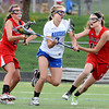 """Centaurus High School's Sarah Brown (3) drives against Regis Jesuit High School's Christina Henderson (17) and Erin Sungelo (25) during their game in Lafayette Thursday. <br /> For more photos from the game go to  <a href=""""http://www.bocopreps.com"""">http://www.bocopreps.com</a><br /> Photo by Paul Aiken / The Camera / April 12, 2011"""