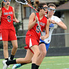 """Centaurus High School's Sarah Cousins (14) defends against Regis Jesuit High School's Taylor Walker (5) during their game in Lafayette Thursday. <br /> For more photos from the game go to  <a href=""""http://www.bocopreps.com"""">http://www.bocopreps.com</a><br /> Photo by Paul Aiken / The Camera / April 12, 2011"""