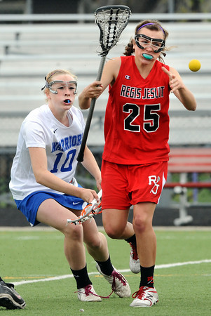 "Centaurus High School's Quinn Trudel (10) and Regis Jesuit High School's Erin Sungelo (25) look after a loose ball during their game in Lafayette Thursday. <br /> For more photos from the game go to  <a href=""http://www.bocopreps.com"">http://www.bocopreps.com</a><br /> Photo by Paul Aiken / The Camera / April 12, 2011"