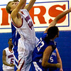 "Zach Taudien (44) of Centaurus High School bangs in under the basketball for an offensive rebound against Nathan Molai during the Warriors game against Englewood High School in Lafayette on Wednesday January 27, 2010. For more photos go to  <a href=""http://www.dailycamera.com"">http://www.dailycamera.com</a>.<br /> Photo by Paul Aiken"