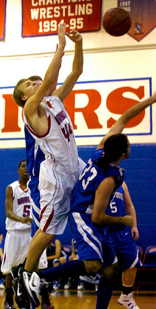 """Zach Taudien (44) of Centaurus High School bangs in under the basketball for an offensive rebound against Nathan Molai during the Warriors game against Englewood High School in Lafayette on Wednesday January 27, 2010. For more photos go to  <a href=""""http://www.dailycamera.com"""">http://www.dailycamera.com</a>.<br /> Photo by Paul Aiken"""