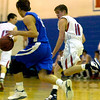 """Harry Higgins (11) of Centaurus High School chases Jesse Kingery (22) down during their game against Englewood High School in Lafayette on Wednesday January 27, 2010. For more photos go to  <a href=""""http://www.dailycamera.com"""">http://www.dailycamera.com</a>.<br /> Photo by Paul Aiken"""