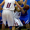 "Cyrus Norwood (5) of Centaurus High School fights through traffic to get to the basket during their game against Englewood High School in Lafayette on Wednesday January 27, 2010. Joel Pleiman (5) tries to stop Norwood. For more photos go to  <a href=""http://www.dailycamera.com"">http://www.dailycamera.com</a>.<br /> Photo by Paul Aiken"