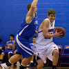 """Ryan Lynch (33) of Centaurus High School drives against Joel Pleiman (5) during their game against Englewood High School in Lafayette on Wednesday January 27, 2010. For more photos go to  <a href=""""http://www.dailycamera.com"""">http://www.dailycamera.com</a>.<br /> Photo by Paul Aiken"""