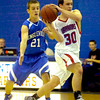 "Will Piers (30) of Centaurus High School prepares to pass while guarded by Gabe Green (21) during the Warriors game against Englewood High School in Lafayette on Wednesday January 27, 2010. For more photos go to  <a href=""http://www.dailycamera.com"">http://www.dailycamera.com</a>.<br /> Photo by Paul Aiken"