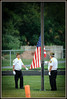Charlotte VFW officials raise flag before the Charlotte vs Eaton Rapids varsity football game at Charlotte.
