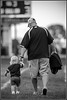 The Big Guy ( Orioles Coach Ostipow ) and the little lady, head to the locker room prior to the Charlotte vs Eaton Rapids game September 7, 2011.
