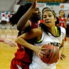"""Legacy High School junior Kailey Edwards drives past Regis freshman Diani Akigbogun on Friday, March 4, in a game against Regis Jesuit High School during the Colorado High School """"Great 8"""" tournament at the Denver Coliseum. Legacy lost the game 59-67. For more photos go to  <a href=""""http://www.dailycamera.com"""">http://www.dailycamera.com</a><br /> Jeremy Papasso/ Camera"""