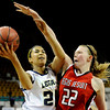 """Legacy High School junior Kailey Edwards gets her shot blocked by Regis sophomore Maddie Montgomery on Friday, March 4, in a game against Regis Jesuit High School during the Colorado High School """"Great 8"""" tournament at the Denver Coliseum. Legacy lost the game 59-67. For more photos go to  <a href=""""http://www.dailycamera.com"""">http://www.dailycamera.com</a><br /> Jeremy Papasso/ Camera"""
