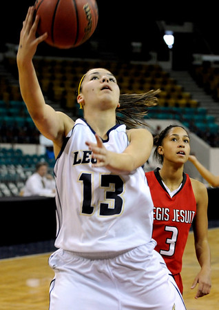 "Legacy High School senior Taylor Archuleta drives to the basket on Friday, March 4, in a game against Regis Jesuit High School during the Colorado High School ""Great 8"" tournament at the Denver Coliseum. Legacy lost the game 59-67. For more photos go to  <a href=""http://www.dailycamera.com"">http://www.dailycamera.com</a><br /> Jeremy Papasso/ Camera"