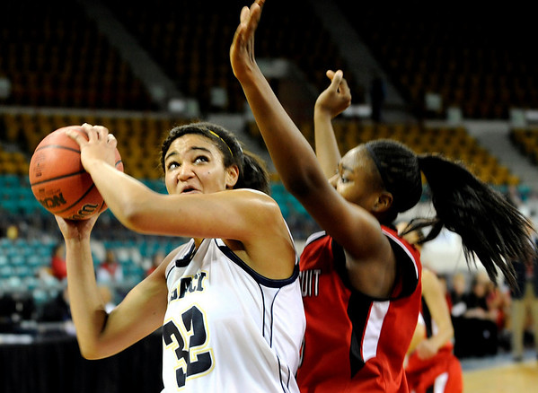 """Legacy High School senior Sade Akindele drives to the hoop on Friday, March 4, in a game against Regis Jesuit High School during the Colorado High School """"Great 8"""" tournament at the Denver Coliseum. Legacy lost the game 59-67. For more photos go to  <a href=""""http://www.dailycamera.com"""">http://www.dailycamera.com</a><br /> Jeremy Papasso/ Camera"""