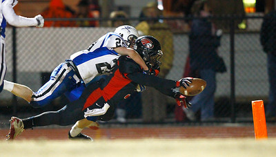 A Signal Mountain player dives for the end zone as a Boyd Buchanan player goes along for the ride