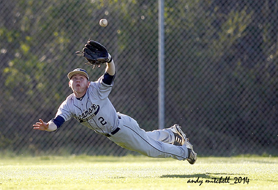 The center fielder for Sycamore high school  makes a diving catch for an out.