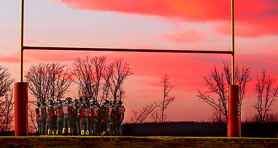 The sun sets over Signal Mountain High-Middle School during a High School Playoff Football game