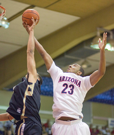 Colorado forward Marcus Relphorde, left, and Arizona forward Derrick Williams (23) reach for a rebound in the first half of an NCAA college basketball game Tuesday, Nov. 24, 2009, at the Maui Invitational in Lahaina, Hawaii. (AP Photo/Eugene Tanner)