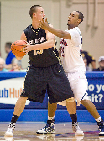 Colorado's Shane Harris-Tunks (13) looks for teammate to pass to while being guarded by Arizona forward Derrick Williams (23) during an NCAA college basketball game Tuesday, Nov. 24, 2009 at the Maui Invitational in Lahaina, Hawaii. (AP Photo/Eugene Tanner)