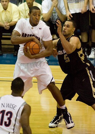 Arizona forward Derrick Williams (23) grabs a rebound while being defended by Colorado forward Marcus Relphorde (5) in the second half of an NCAA college basketball game Tuesday Nov. 24, 2009 at the Maui Invitational in Lahaina, Hawaii. Arizona defeated Colorado 91-87 in overtime.  (AP Photo/Eugene Tanner)