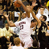 Arizona forward Derrick Williams (23) grabs a rebound from Colorado forward Casey Crawford (34) in the second half of an NCAA college basketball game Tuesday Nov. 24, 2009 at the Maui Invitational in Lahaina, Hawaii. Arizona defeated Colorado 91-87 in overtime.  (AP Photo/Eugene Tanner)