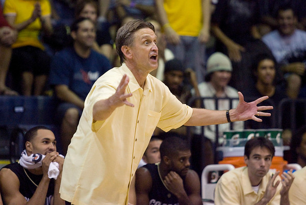 Colorado assistant head coach Steve McClain gestures and shouts instructions to his team in the second half half of an NCAA college basketball game Tuesday Nov. 24, 2009 at the Maui Invitational in Lahaina, Hawaii. Arizona defeated Colorado 91-87 in overtime.  (AP Photo/Eugene Tanner)