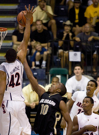 Arizona forward Jamelle Horne (42) blocks the shot of Colorado guard Alec Burks (10) in the second half of an NCAA college basketball game Tuesday Nov. 24, 2009 at the Maui Invitational in Lahaina, Hawaii. Arizona defeated Colorado 91-87 in overtime.  (AP Photo/Eugene Tanner)