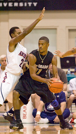 Arizona guard Kyle Fogg (21) tries to hold position on Colorado guard Cory Higgins (11) in the first half of an NCAA college basketball game Tuesday, Nov. 24, 2009, at the Maui Invitational in Lahaina, Hawaii. (AP Photo/Eugene Tanner)