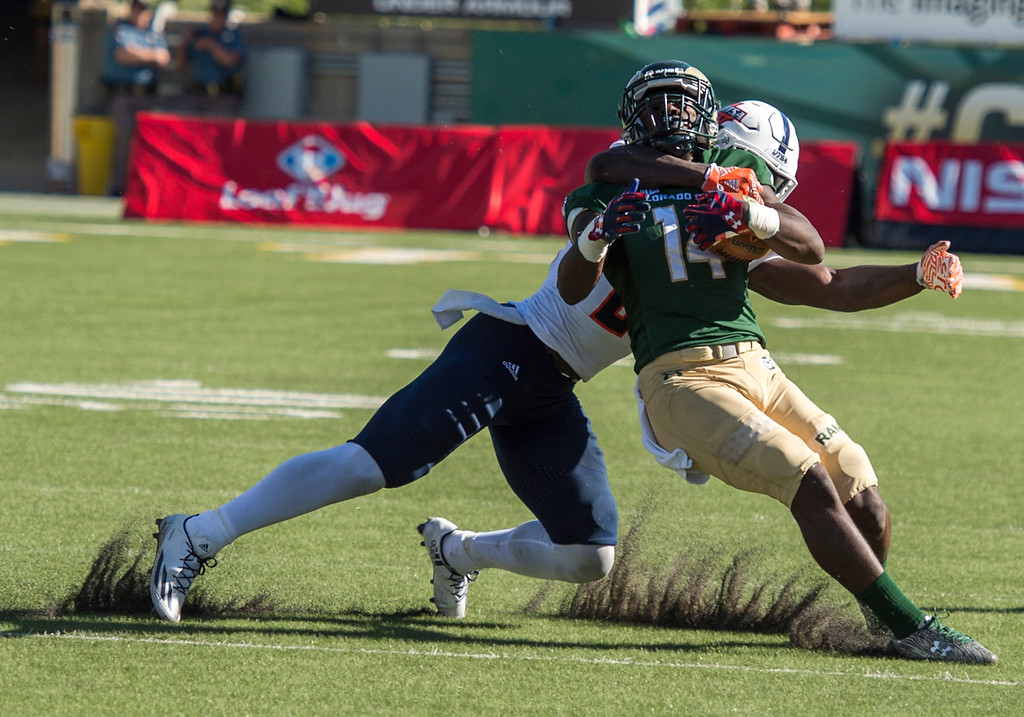 . UTSA safety Jordan Moore (29) tackles Colorado State wide receiver Anthony Hawkins (14) Saturday afternoon Sept. 10, 2016 at Hughes Stadium in Fort Collins during a 23-14 Rams home win. (Photo by Michael Brian/Loveland Reporter-Herald)