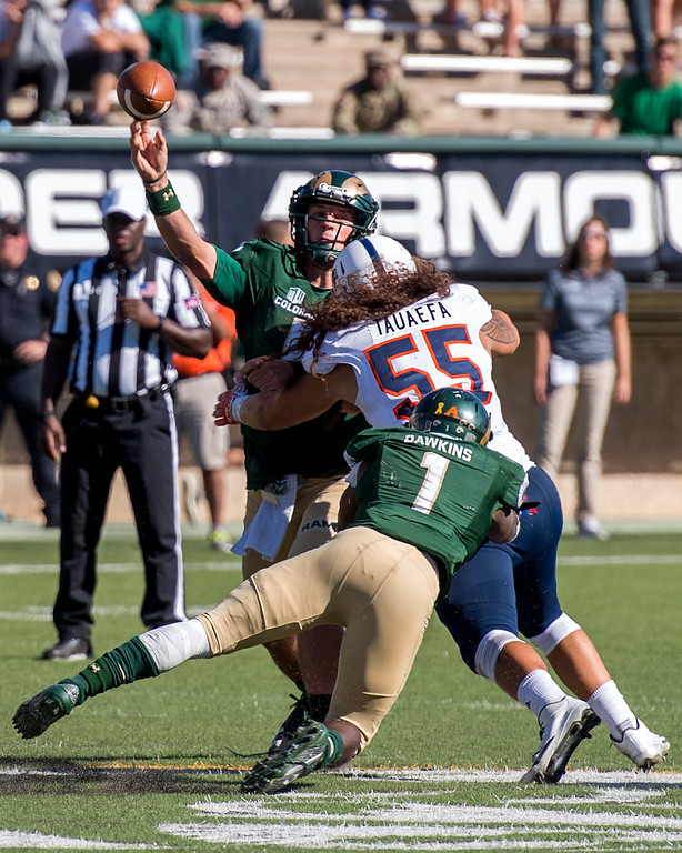 . Colorado State quarterback Faton Bauta (5) just gets the ball out as UTSA linebacker Josiah Tauaefa (55) gets past Rams running back Dalyn Dawkins (1) Saturday afternoon Sept. 10, 2016 at Hughes Stadium in Fort Collins. The Rams won the game, 23-14. (Photo by Michael Brian/Loveland Reporter-Herald)