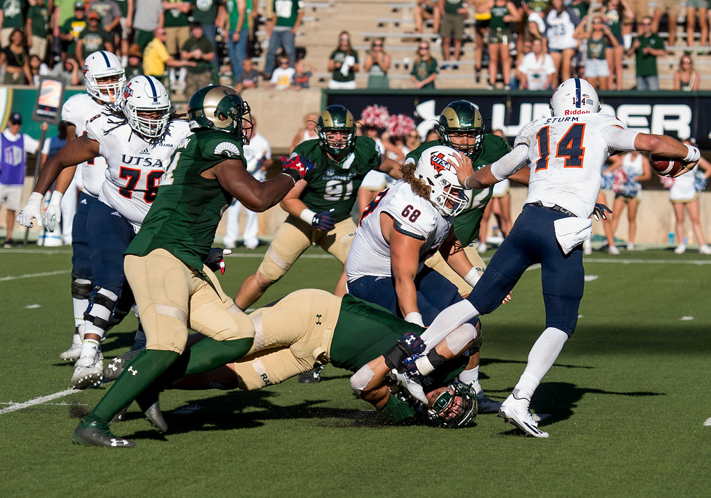 . Colorado State linebacker Evan Colorito (43) gets a grip on UTSA quarterback Dalton Sturm (14) that would lead to a sack Saturday afternoon Sept. 10, 2016 at Hughes Stadium in Fort Collins. The Rams beat the Roadrunners, 23-14. (Photo by Michael Brian/Loveland Reporter-Herald)