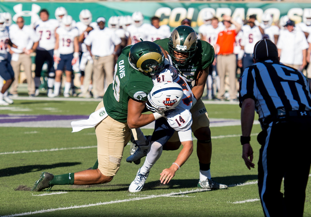 . Colorado State linebackers Kevin Davis (33) and Josh Watson (55) sack UTSA quarterback Dalton Sturm (14) late in the game Saturday afternoon Sept. 10, 2016 at Hughes Stadium in Fort Collins. The Rams won, 23-14. (Photo by Michael Brian/Loveland Reporter-Herald)