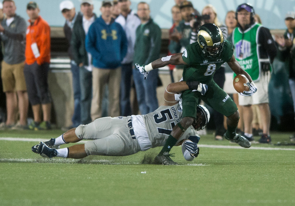 . Colorado State wide receiver Detrich Clark (8) gets taken down by Utah State linebacker Leki Uasike (57) Saturday evening Oct. 8, 2016 at Hughes Stadium in Fort Collins. (Photo by Michael Brian/Loveland Reporter-Herald)