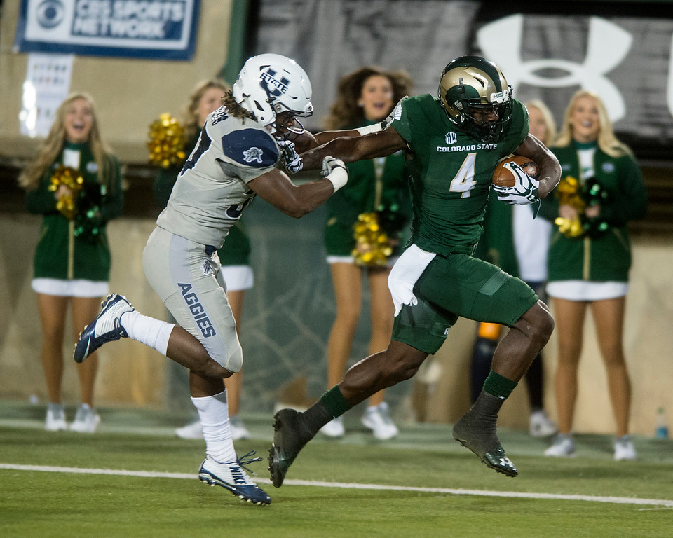. Colorado State wide receiver Michael Gallup (4) breaks away from Utah State free safety Devin Centers Saturday evening Oct. 8, 2016 at Hughes Stadium in Fort Collins. (Photo by Michael Brian/Loveland Reporter-Herald)