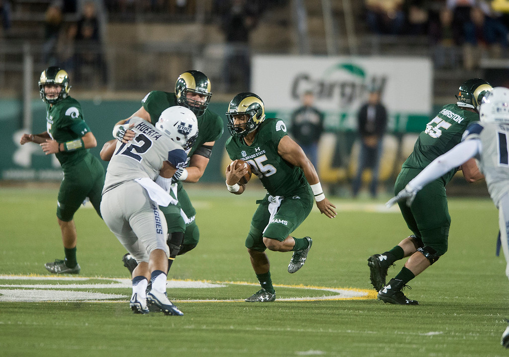 . Colorado State running back Izzy Matthews (35) runs against Utah State Saturday evening Oct. 8, 2016 at Hughes Stadium in Fort Collins. (Photo by Michael Brian/Loveland Reporter-Herald)