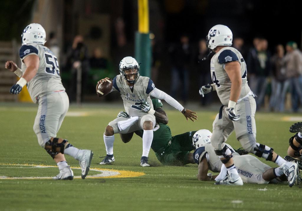 . Colorado State linebacker Bryan Ohene-Gyeni (36) takes down Utah State quarterback Kent Myers (2) Saturday evening Oct. 8, 2016 at Hughes Stadium in Fort Collins. (Photo by Michael Brian/Loveland Reporter-Herald)