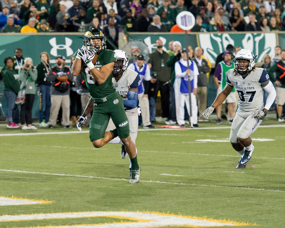 . Colorado State wide receiver Olabisi Johnson (81) snags a touchdown catch against Utah State cornerback Daniel Gray (7) Saturday evening Oct. 8, 2016 to put the Rams ahead of the Aggies 10-7 in the first quarter at Hughes Stadium in Fort Collins. (Photo by Michael Brian/Loveland Reporter-Herald)