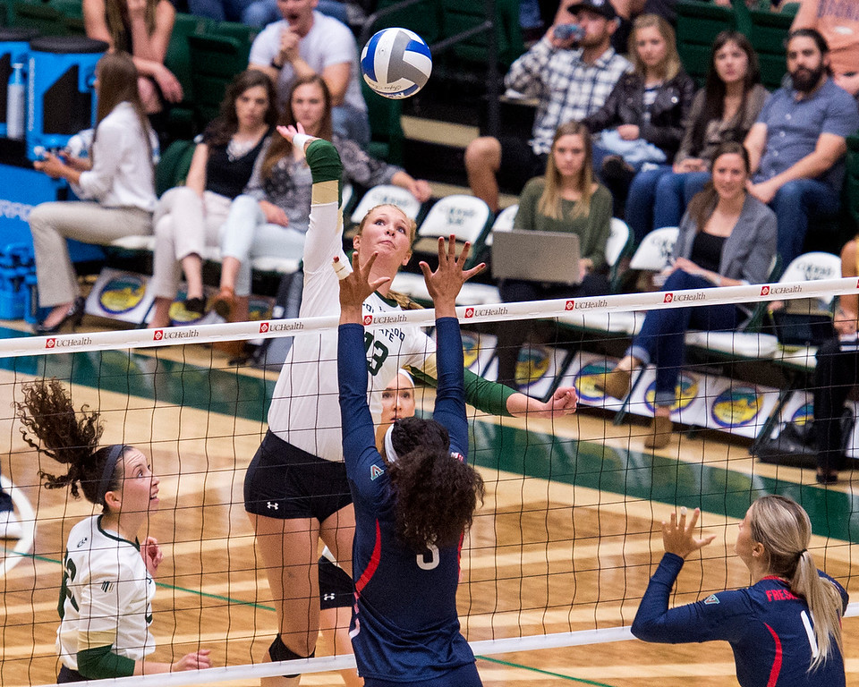 . Colorado State middle blocker Kristie Hillyer (13) gets up for a shot against Fresno State Thursday evening Sept. 22, 2016 at Moby Arena in Fort Collins. (Photo by Michael Brian/Loveland Reporter-Herald)