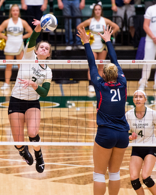 . Colorado State outside hitter Olivia Nicholson (3) drives a shot into the Fresno State defense Thursday evening Sept. 22, 2016 at Moby Arena in Fort Collins. (Photo by Michael Brian/Loveland Reporter-Herald)