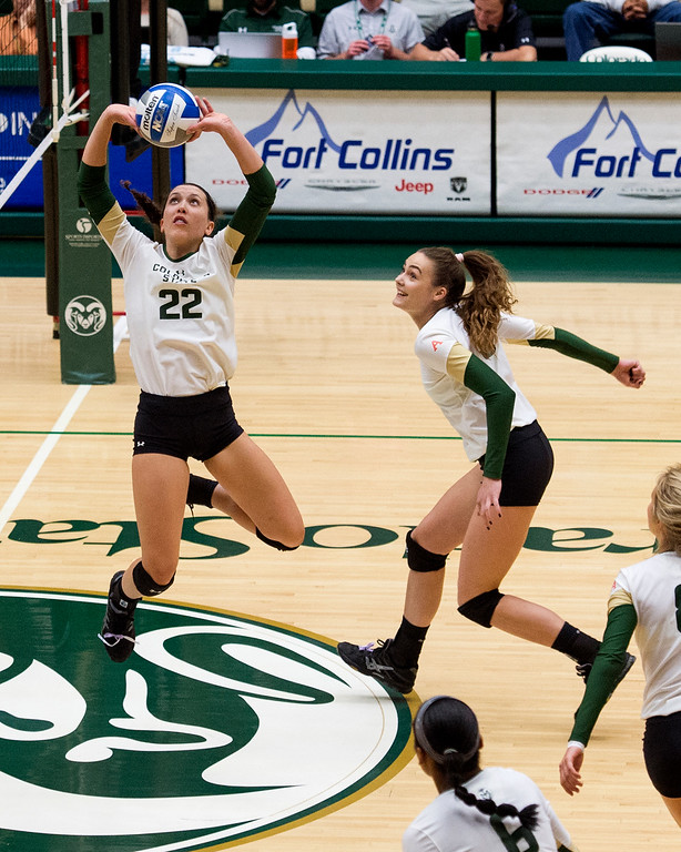 . Colorado State freshman Katie Oleksak (22) sets for teammate Paulina Hougaard-Jensen (9) as the Rams face the San Jose State Spartans Saturday afternoon Sept. 24, 2016. (Photo by Michael Brian/Loveland Reporter-Herald)