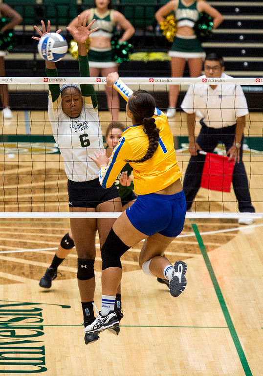 . Colorado State outside hitter Jasmine Hanna (6) closes her eyes and gets a block against San Jose State Saturday afternoon Sept. 24, 2016. (Photo by Michael Brian/Loveland Reporter-Herald)
