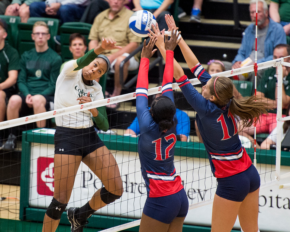 . Colorado State\'s Jasmine Hanna, left, drives a shot into Gaels middle blockers Alex O\'Sullivan (12), center, and Alexis Salmons (11) Saturday evening August 27, 2016 at Moby Arena in Fort Collins. (Photo by Michael Brian/Loveland Reporter-Herald)