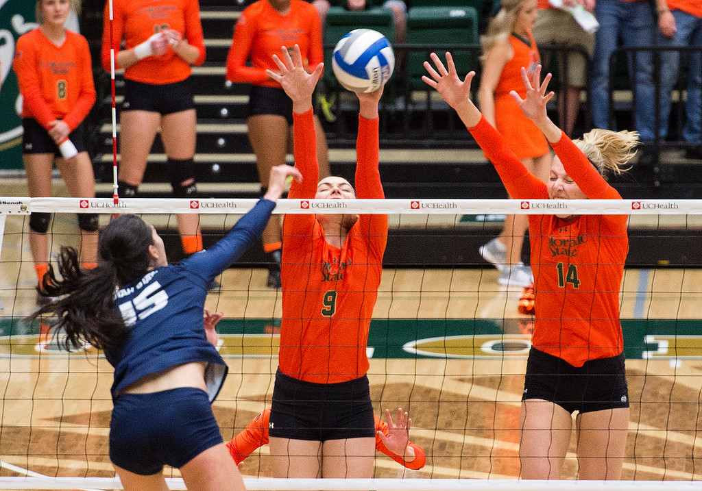 . Colorado State\'s Paulina Hougaard-Jensen (9) and Alexandra Poletto (14) get up for the block attempt against Utah State\'s Kaylie Kamula-Smith (15) Saturday afternoon Oct., 29, 2016 at Moby Arena in Fort Collins. The Rams beat the Aggies, 3-0. (Photo by Michael Brian/Loveland Reporter-Herald)