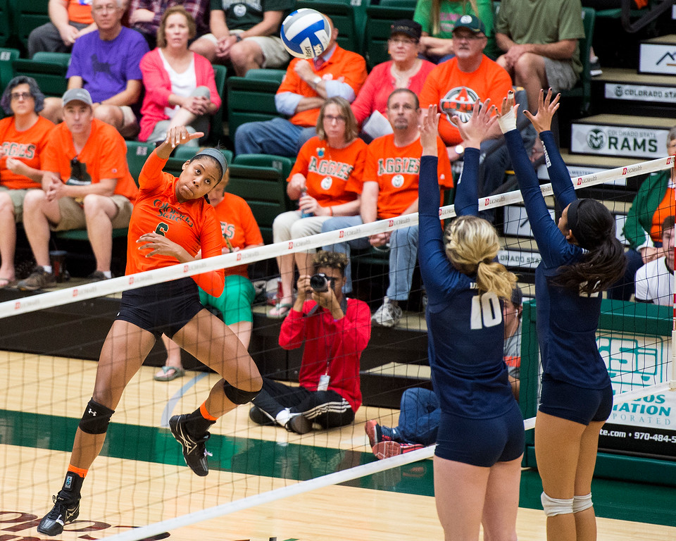 . Colorado State outside hitter Jasmine Hanna (6) drives a shot into the Utah State defense Saturday afternoon Oct., 29, 2016 at Moby Arena in Fort Collins. The Rams win in straight sets, 3-0. (Photo by Michael Brian/Loveland Reporter-Herald)