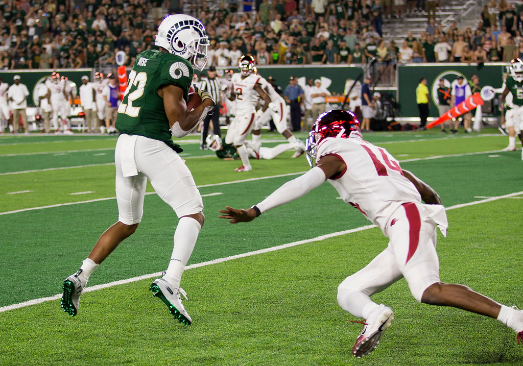 . Colorado State wide receiver Darius Wise (22) grabs a pass against Arkansas defensive back Britto Tutt (14) Saturday evening Sept., 8, 2018 at Canvas Stadium in Fort Collins. The Rams prevailed, 34-27. (Michael Brian/For the Reporter-Herald)